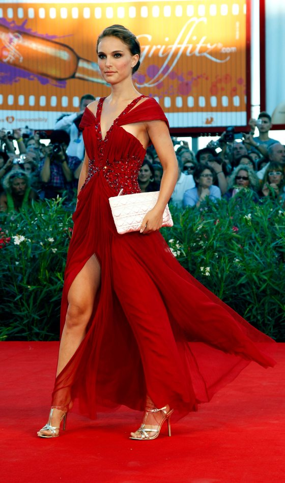 "Actress Portman poses for photographers during the ""Black Swan"" red carpet at the 67th Venice Film Festival"