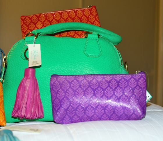 {Fuchsia Tassel Key Ring & Orange and Purple Neem Clutches, shown with green J. Crew Bag}