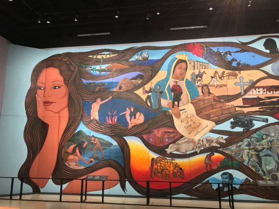 L.A.'s Untold History Unfolds: Chicana Artist Barbara Carrasco's Acclaimed Mural Is On Exhibit in Los Angeles